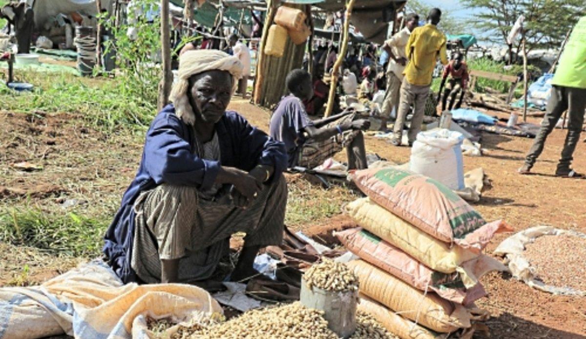 Peanut vendor in Amiet market