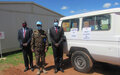 UNISFA's presents the key of a Toyota Landcruiser to Abyei Ministry of Health